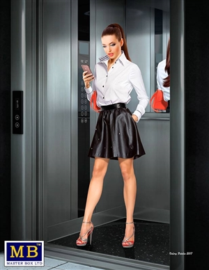 "Ali ""Status Check"" Modern woman wearing short skirt with cell phone in hand (1/24)"